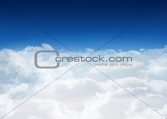 Bright blue sky over clouds