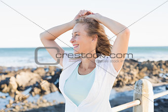 Casual woman smiling by the sea