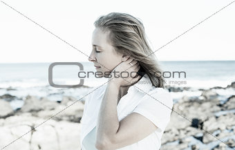 Casual woman standing by the sea