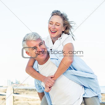 Casual couple having fun by the sea