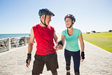 Fit mature couple rollerblading on the pier