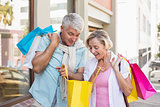 Happy mature couple looking at their shopping purchases