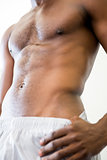 Close-up mid section of shirtless muscular man
