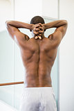 Rear view of a shirtless muscular man