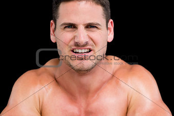 Close up portrait of a young muscular man
