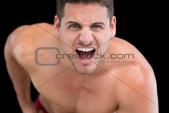 Close up portrait of young muscular man shouting