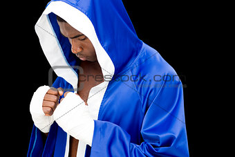 Muscular boxer in in blue hood