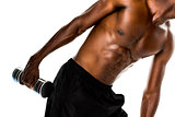 Mid section of fit shirtless young man lifting dumbbell