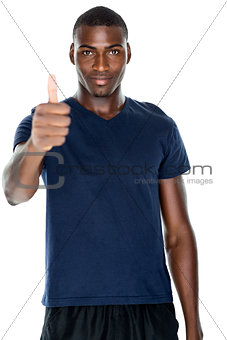 Portrait of smiling man gesturing thumbs up