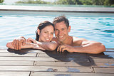 Couple in swimming pool on a sunny day