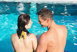 Smiling young couple in swimming pool