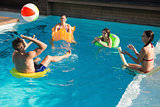 People playing with ball in swimming pool