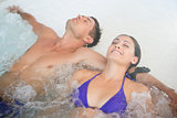 Relaxed couple in swimming pool