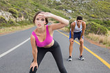 Fit young couple running on road