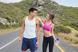 Portrait of a fit couple standing on road