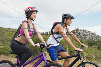 Athletic couple mountain biking