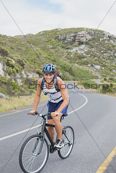 Athletic young man mountain biking