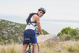 Portrait of athletic man mountain biking