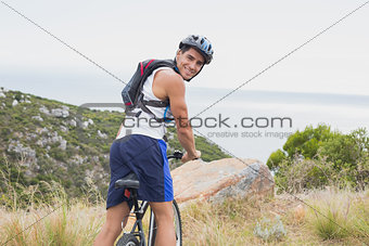 Portrait of athletic man mountain biking