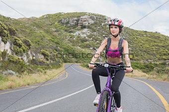 Athletic woman mountain biking