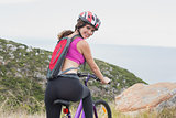 Portrait of athletic woman mountain biking
