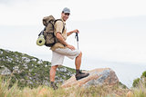 Hiking man walking on mountain terrain