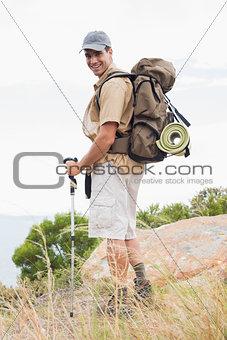 Portrait of hiking man walking on mountain terrain