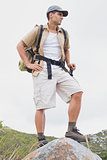 Hiking man standing on mountain terrain