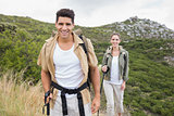 Couple walking on mountain terrain