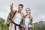 Couple pointing on country terrain