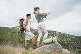Hiking couple standing on mountain terrain