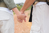 Close up of hiking couple holding hands