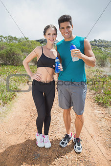 Fit couple standing on countryside landscape