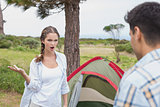 Couple with tent on countryside landscape