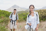 Hiking couple walking on countryside landscape