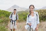 Hiking couple walking on countryside landscape