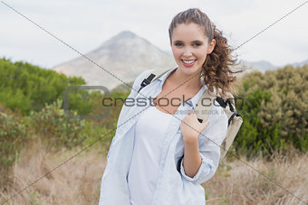 Smiling woman standing on countryside landscape