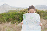 Portrait of a hiking young woman holding map