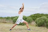 Man doing stretching exercises on countryside landscape