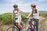 Athletic couple mountain biking