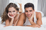 Portrait of romantic couple in bed