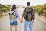 Hiking couple standing on countryside road