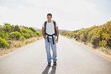 Hiking man walking on countryside road