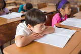 Bored pupil sitting at his desk