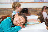 Sleeping pupil sitting at her desk
