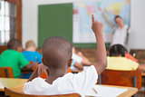Pupil raising hand in classroom