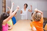 Cute pupils raising their hands in class