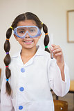 Cute pupil dressed up as scientist in classroom
