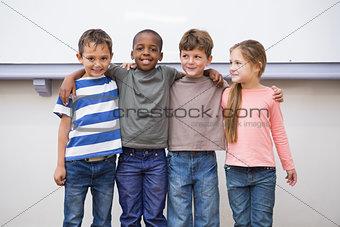 Classmates smiling at camera in classroom