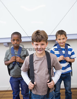 Classmates smiling together in classroom